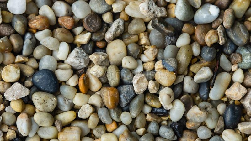 Abstract pebble stones background texture macro, selective focus stock images