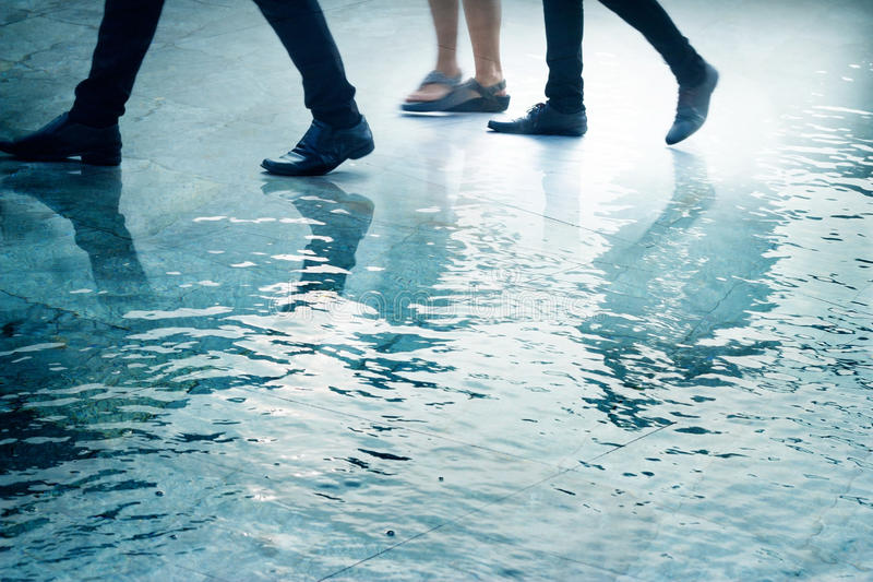 Abstract people walk in the water on street city, pastel color tone royalty free stock image