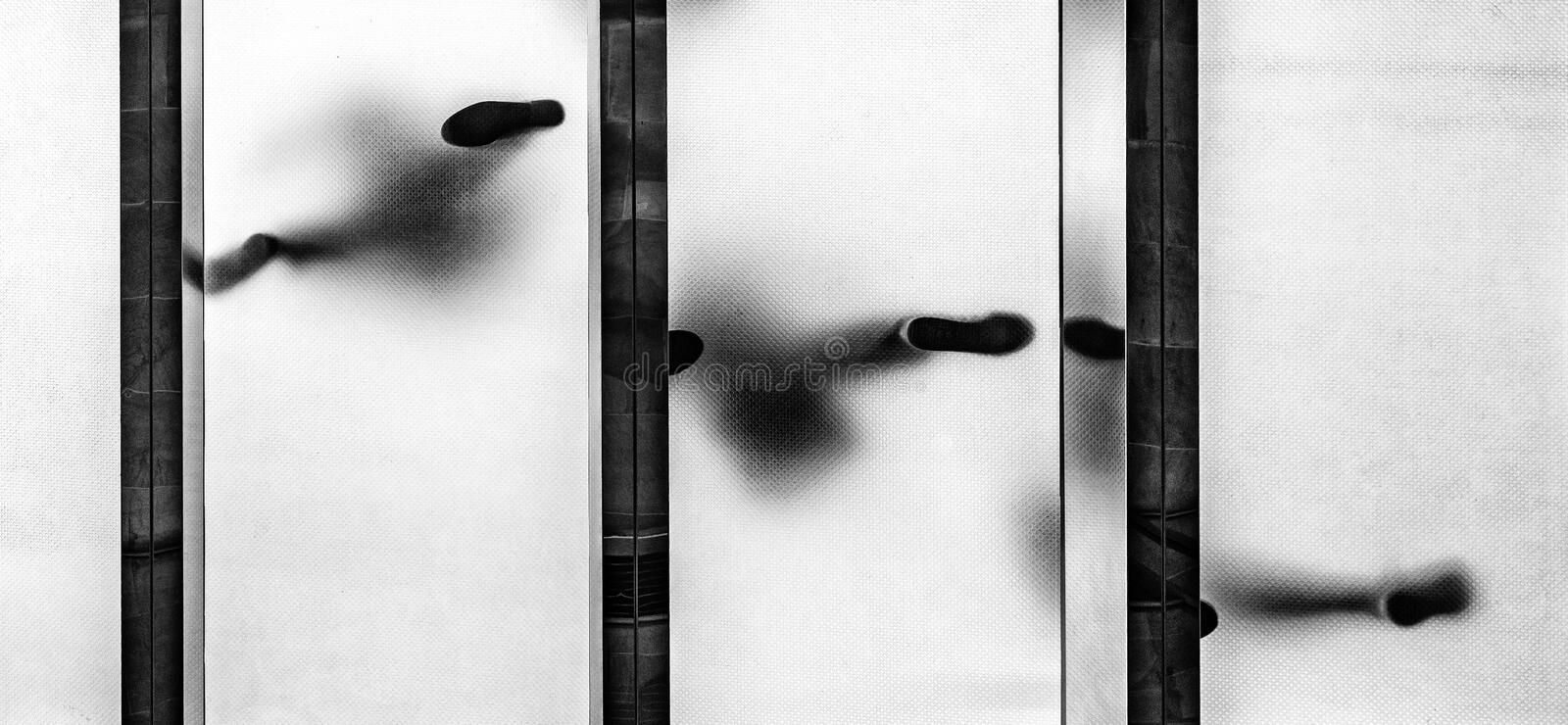 Abstract people walking on a glass floor. In monochrome style stock photos