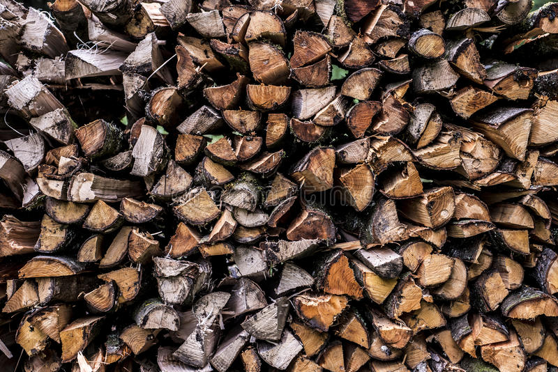 Abstract photo pile natural wood background dry chopped firewood logs ready for winter stock photo