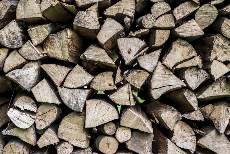 Abstract photo pile natural wood background dry chopped firewood logs ready for winter stock photography