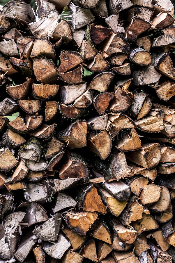 Abstract photo pile natural wood background dry chopped firewood logs ready for winter royalty free stock image