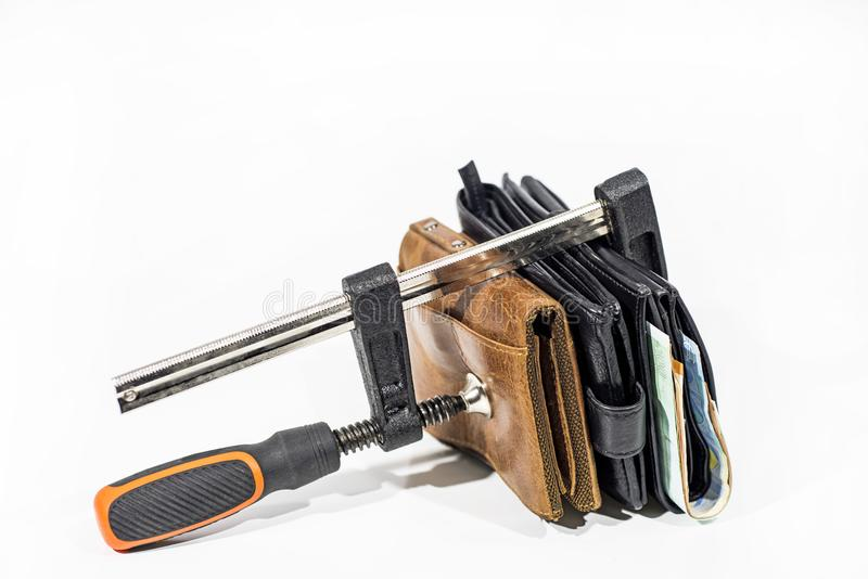 Abstract photo. Purse under clamp. Isolated on white background stock images