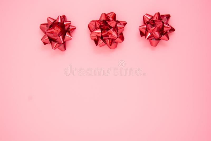 Abstract pink background with red gift ribbon bows. Valentine's Day, Love, birthday stock photo