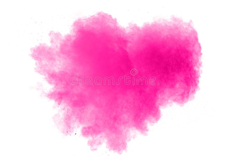 Abstract pink color powder explosion on white background. Freeze motion of pink dust particles splashing royalty free stock photos