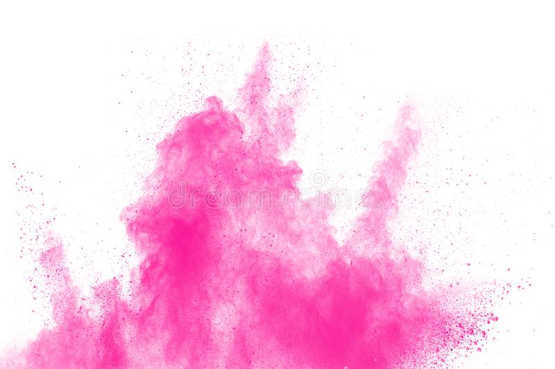 Abstract pink dust explosion on white background. Freeze motion of pink powder splash.  stock photo