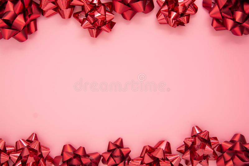 Abstract pink frame with red gift ribbon bows. Valentine's Day, Love, birthday royalty free stock photos