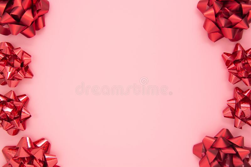 Abstract pink frame with red gift ribbon bows. Valentine's Day, Love, birthday royalty free stock photography