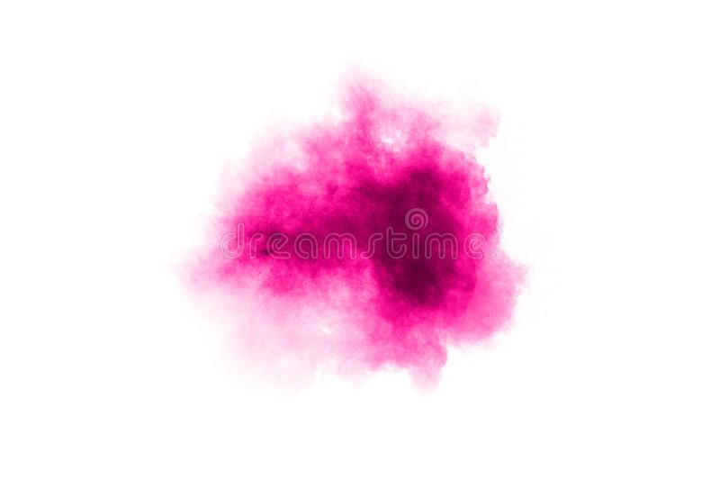 Abstract pink powder explosion on white background. Freeze motion of pink dust splattered. Abstract pink powder explosion on white background. Freeze motion of royalty free stock image