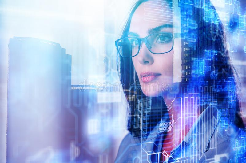 Abstract portrait of attractive young businesswoman. In city with tech pattern. Technology and employment concept. Double exposure royalty free stock images