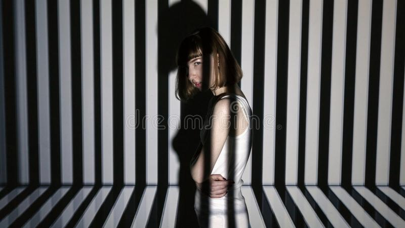 Abstract portrait of a beautiful girl in the light of the projector stock images