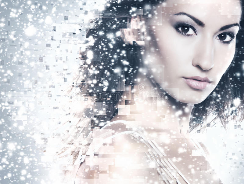 Abstract portrait of young and beautiful woman. Over the winter background royalty free stock image