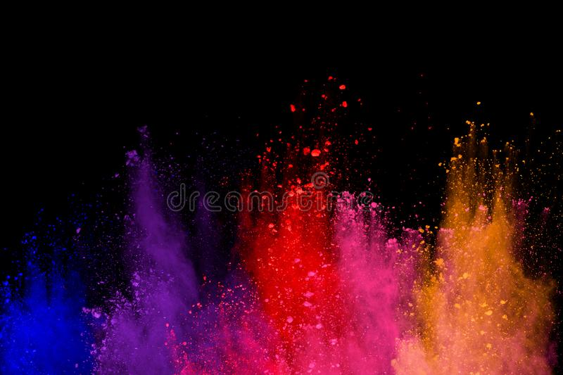 Abstract powder splatted background. Colorful powder explosion on black background. Colored cloud. Colorful dust explode. Paint Ho. Li stock photo
