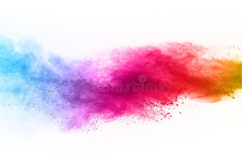 Abstract powder splatted background. Colorful powder explosion on white background. stock images