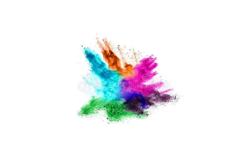 Colorful powder explosion on white background. stock photos