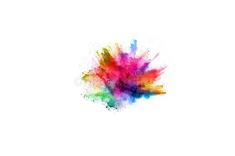Colorful powder explosion on white background. stock photo