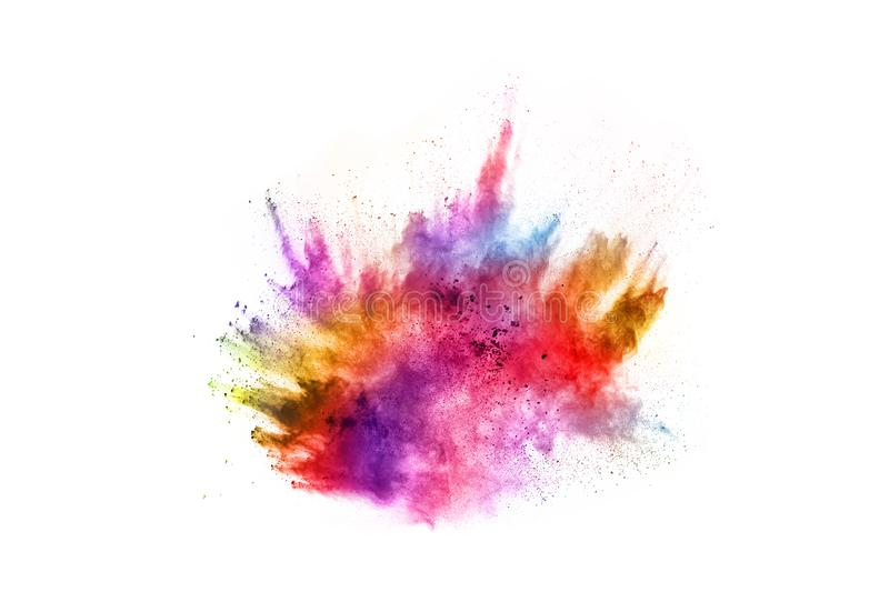 Colorful powder explosion on white background stock photos