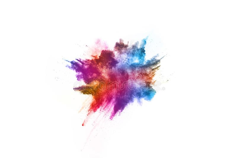 Colorful powder explosion on white background stock images