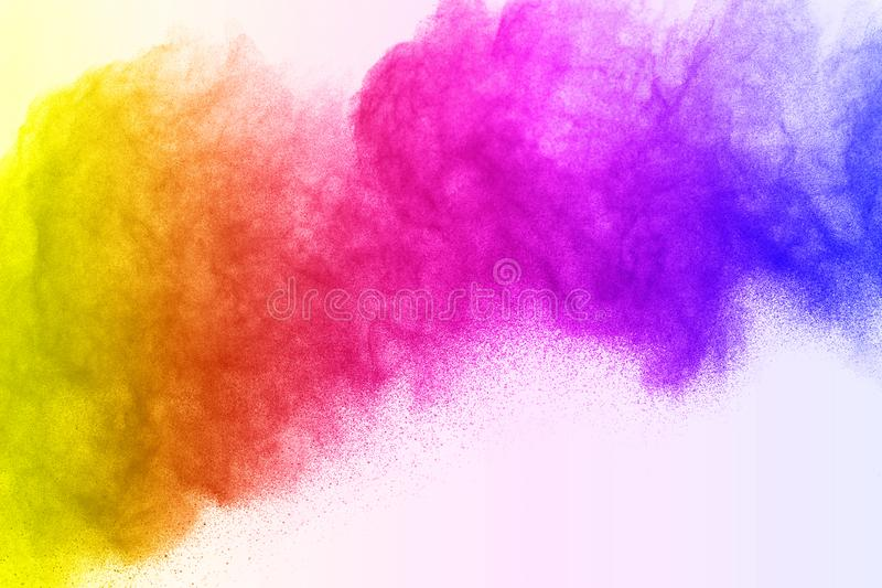 Abstract powder splatted islate on white background,Freeze motion of colorful powder exploding/throwing color stock image