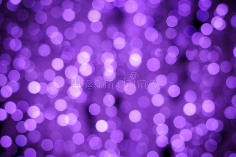 Abstract purple background with night lights of bokeh. Blurred backdrop, defocused shiny circles. Texture with illuminated effect.  stock image