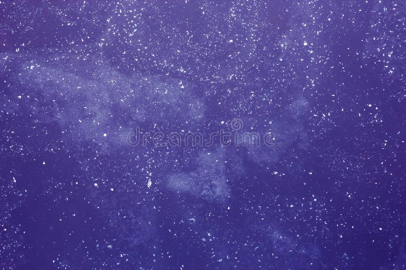 Abstract purple background with white spots, deep space with man royalty free stock images