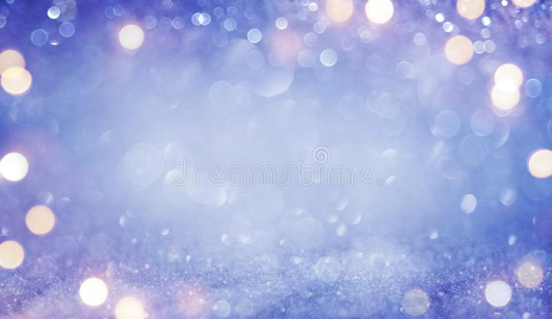 Abstract purple and blue defocused glitter vintage lights background stock images
