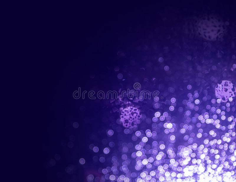 Abstract of purple bokeh of rains water on glasses ,defocused lights glitter  background.Background decorative christmas ,happy. New year bokeh lights concept royalty free stock photo