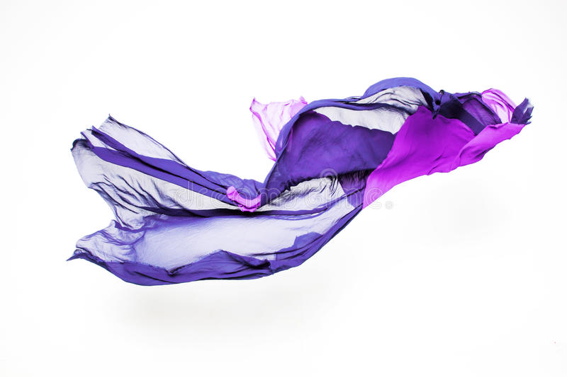 Abstract purple fabric in motion. Set of abstract pieces of purple fabric flying, high-speed studio shot stock photography