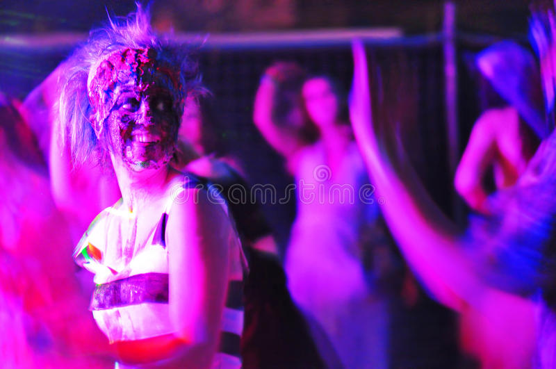 Abstract purple people dancing nightclub royalty free stock photography