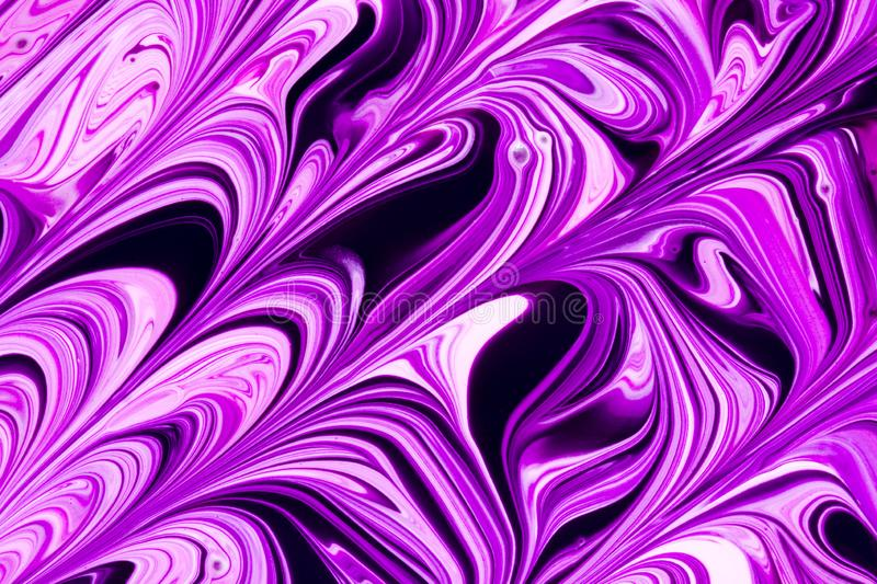 Abstract purple, pink and black paint swirls stock photo
