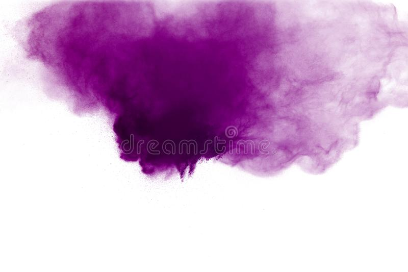 Abstract purple powder explosion on white background. Freeze motion of colored dust splattered royalty free stock images