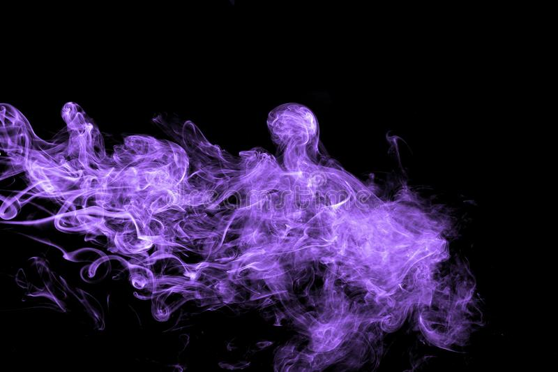 Abstract purple smoke flow in black background. royalty free stock photography