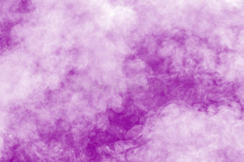 Abstract purple smoke flow in black background.Dramatic purple smoke clouds royalty free stock photos