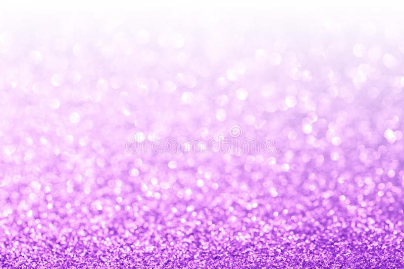 Abstract purple and white bokeh glitter background stock photography