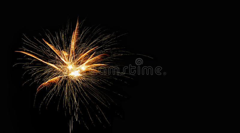 Abstract pyrotechnic glowing explosion on black background. fireworks landscape. Golden flash. Festival card design. Template stock photos