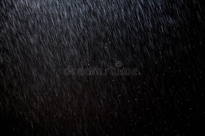 Abstract rain texture background. background rain in night light stock photo