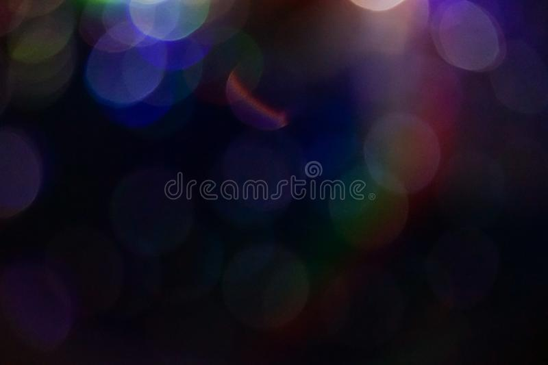 Abstract rainbow bokeh with black background. stock photography
