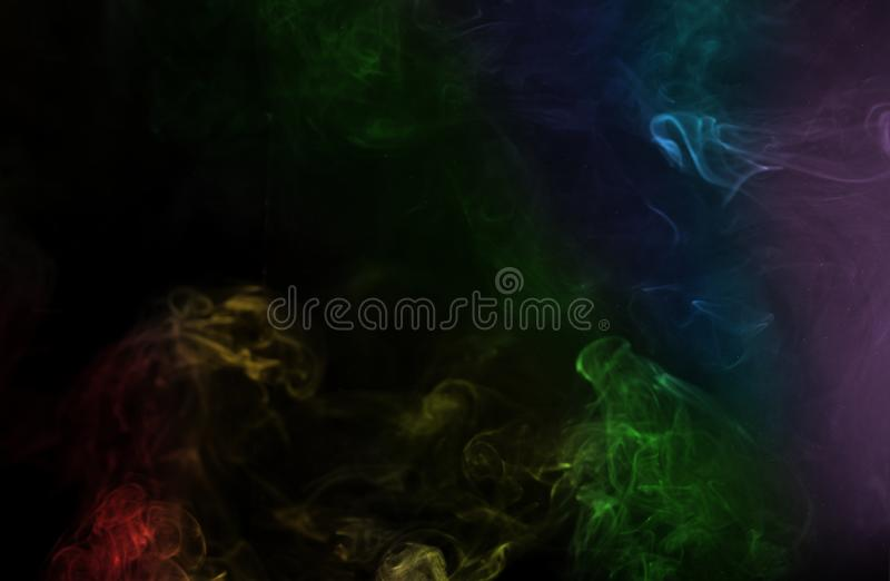 Abstract rainbow color smoke on black background. Abstract smoke image on black background, air, backdrop, blow, cigarette, collection, compositing, curve stock photography