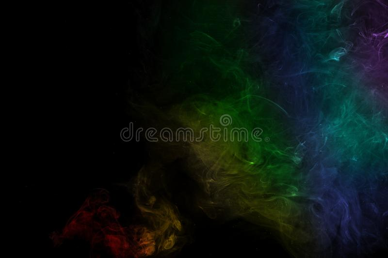 Abstract rainbow color smoke on black background. Abstract smoke image on black background, air, backdrop, blow, cigarette, collection, compositing, curve stock images