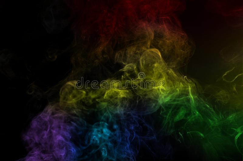 Abstract rainbow color smoke on black background. Abstract smoke image on black background, air, backdrop, blow, cigarette, collection, compositing, curve royalty free stock photos