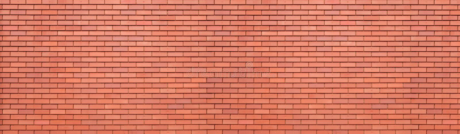 Abstract red brick wall texture background. Horizontal panoramic view of masonry brick wall. royalty free stock photo