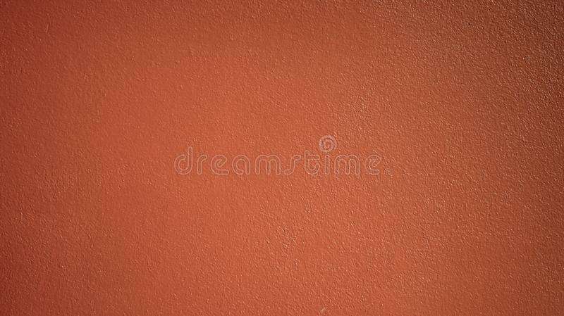 Old red tone cement wall texture background. Abstarct red-brown tone concrete wall textured background stock image