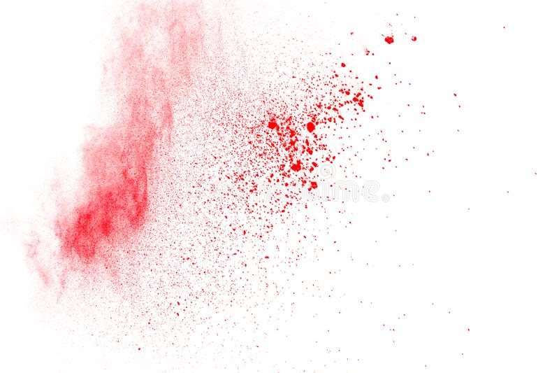 Abstract red dust explosion on white background. Freeze motion of red powder splash.  stock images