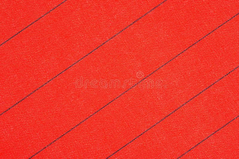 Abstract red fabric with black stripes texture background. Book cover. royalty free stock images