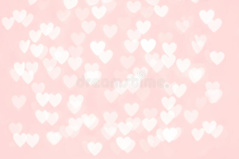 Abstract red heart glitter light bokeh holiday party background. Abstract red pink heart glitter light bokeh holiday and festive party background. Love sentiment stock images