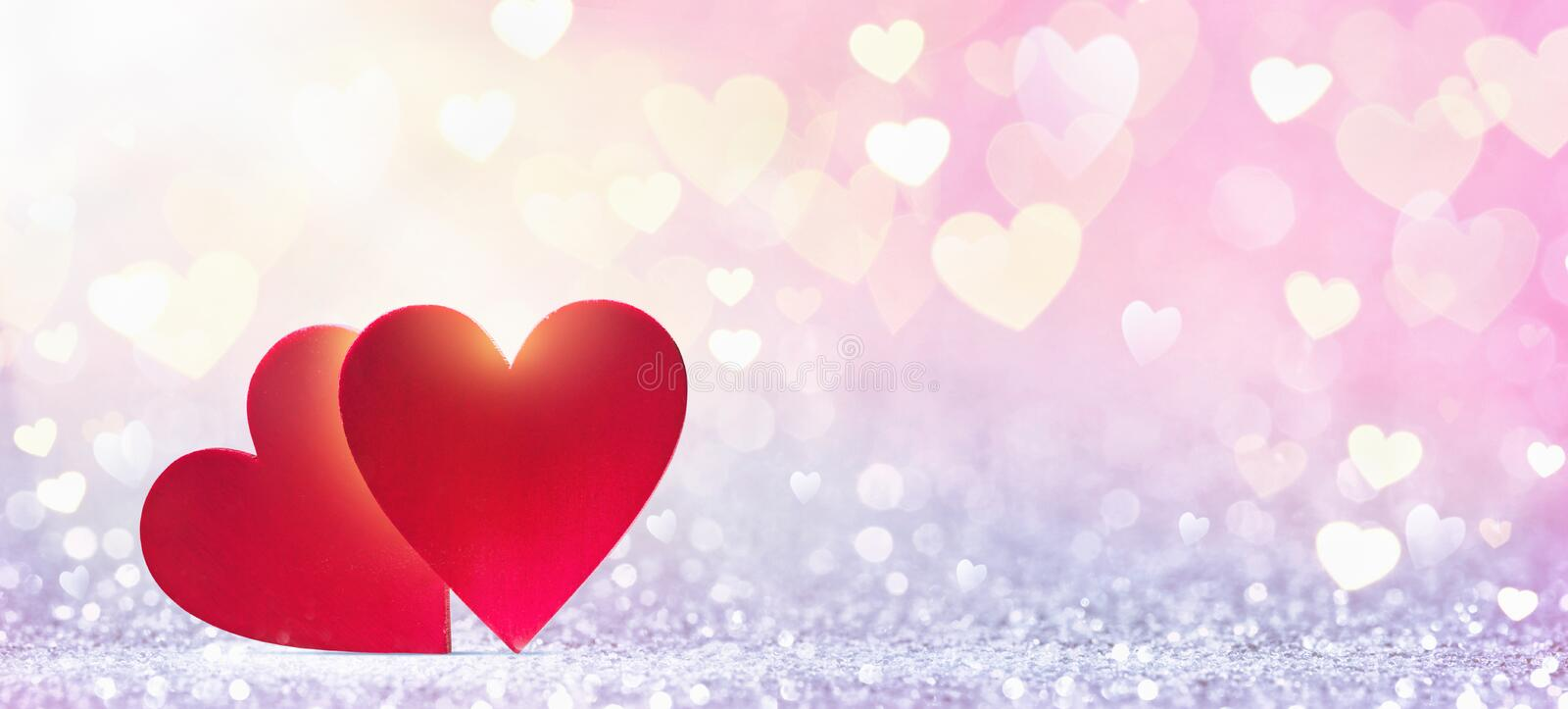 Abstract red hearts in sunlight stock photo