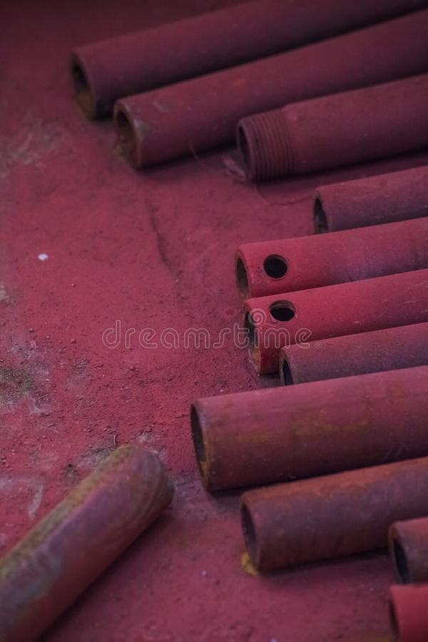 Abstract red metall pipe on the floor stock photo