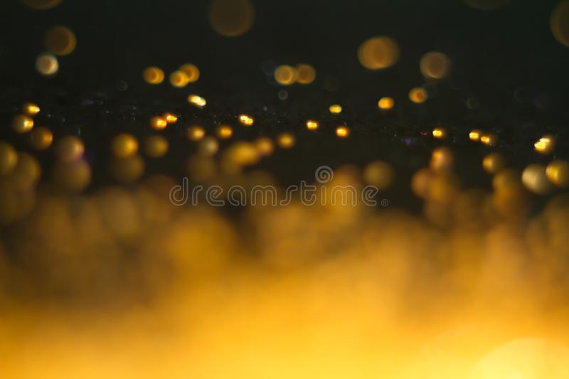 Abstract red-orange bokeh on a black background. Defocused. Free space for text royalty free stock photography
