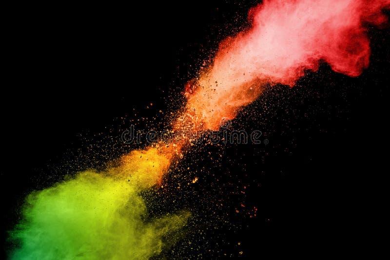 Abstract red orange powder explosion on white background.Freeze motion of red orange dust splash.  stock photo