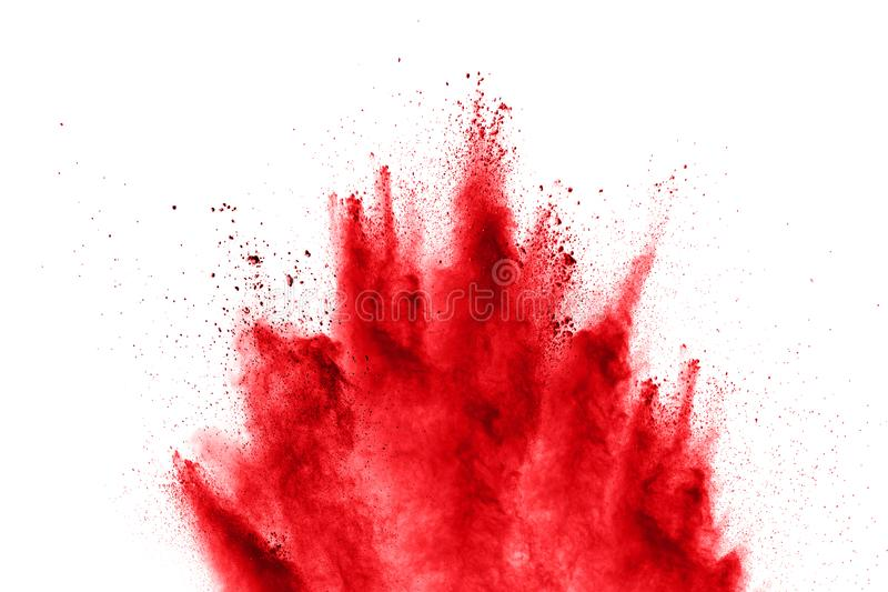 Abstract red powder explosion on white background. abstract red dust splattered on background. stock images